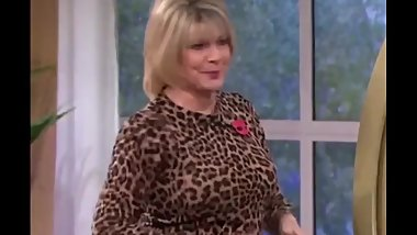 British milf TV presenter Ruth Langsford in a brown leather skirt